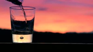 stock-footage-pouring-scotch-whiskey-in-sunset